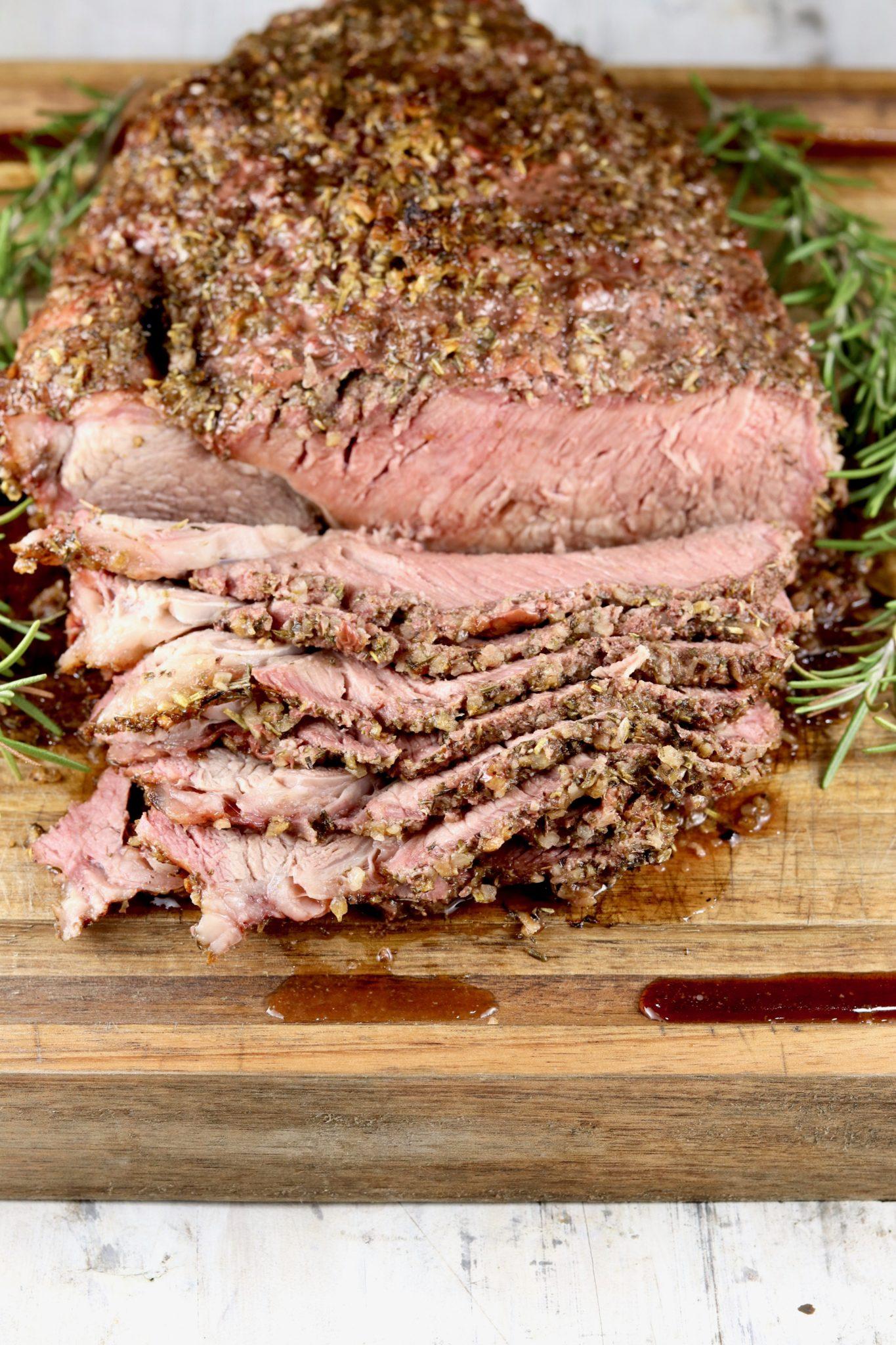 Sliced roast beef with herbs
