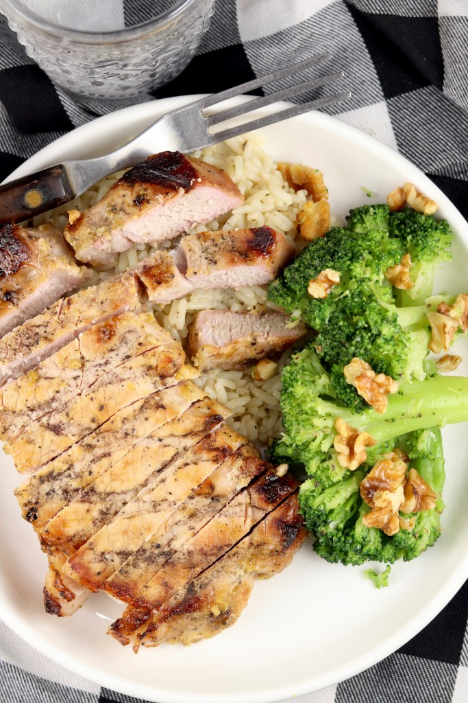 Pork chop on a plate with broccoli