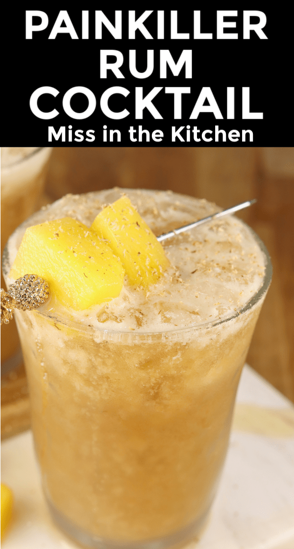 Rum cocktail with pineapple juice and cream of coconut. Garnished with pineapple chunks.