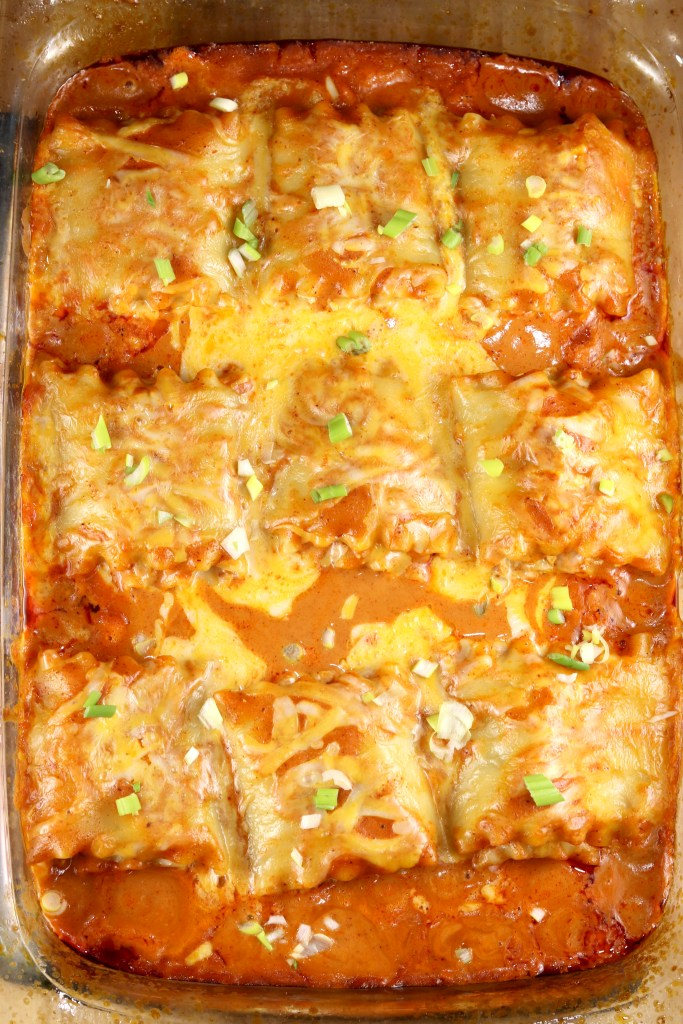 Pan of chicken enchilada lasagna roll ups