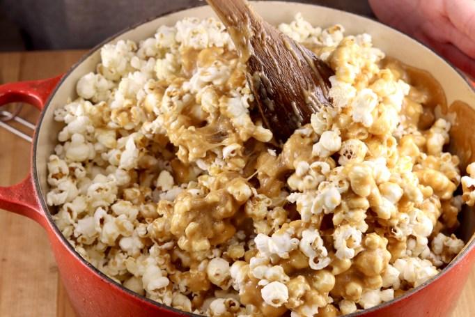 Making caramel popcorn with homemade caramel sauce