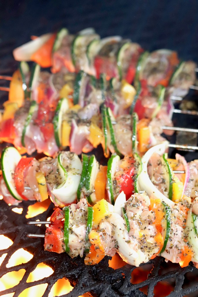 Grilled Chicken Kebabs with vegetables on a grill