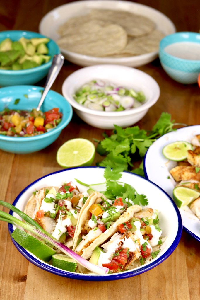 Grilled fish tacos with lime crema, salsa and cilantro