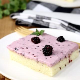 Slice of Blackberry Sheet Cake with fresh blackberry garnish