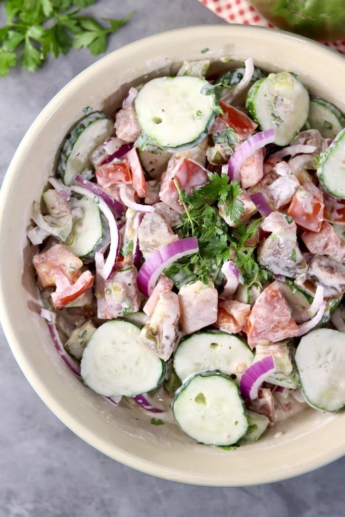 Creamy Cucumber Tomato Salad with red onion and herbs
