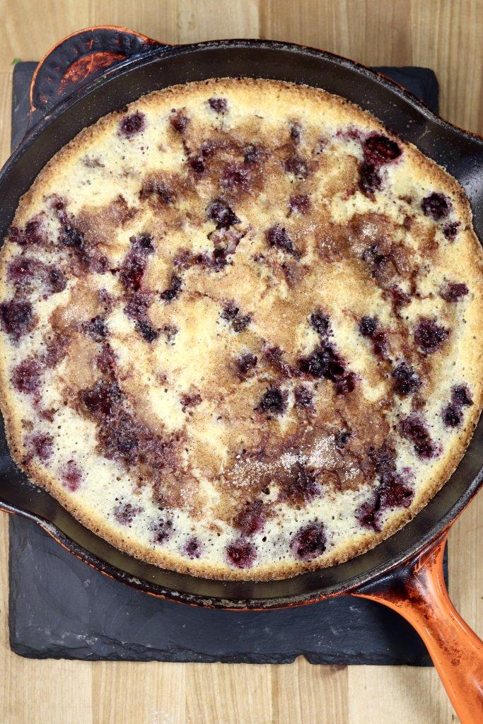 Baked skillet blackberry cobbler with cinnamon