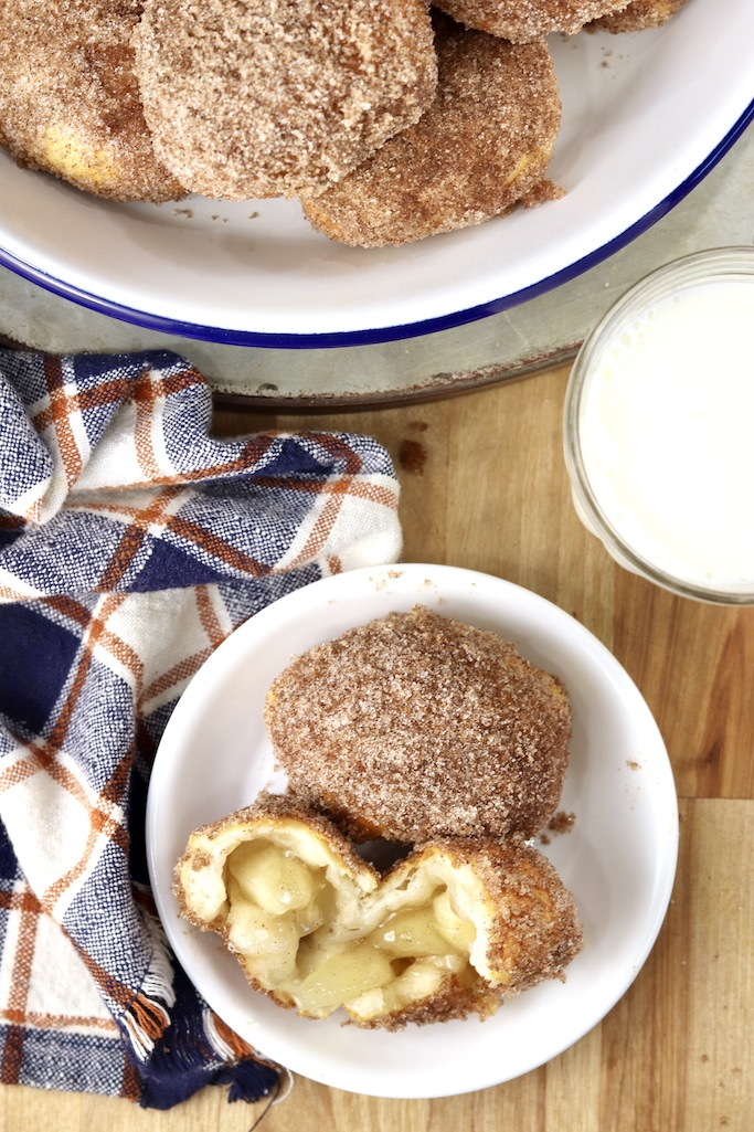 Apple Pie bombs with cinnamon and sugar plated and in a pie plate