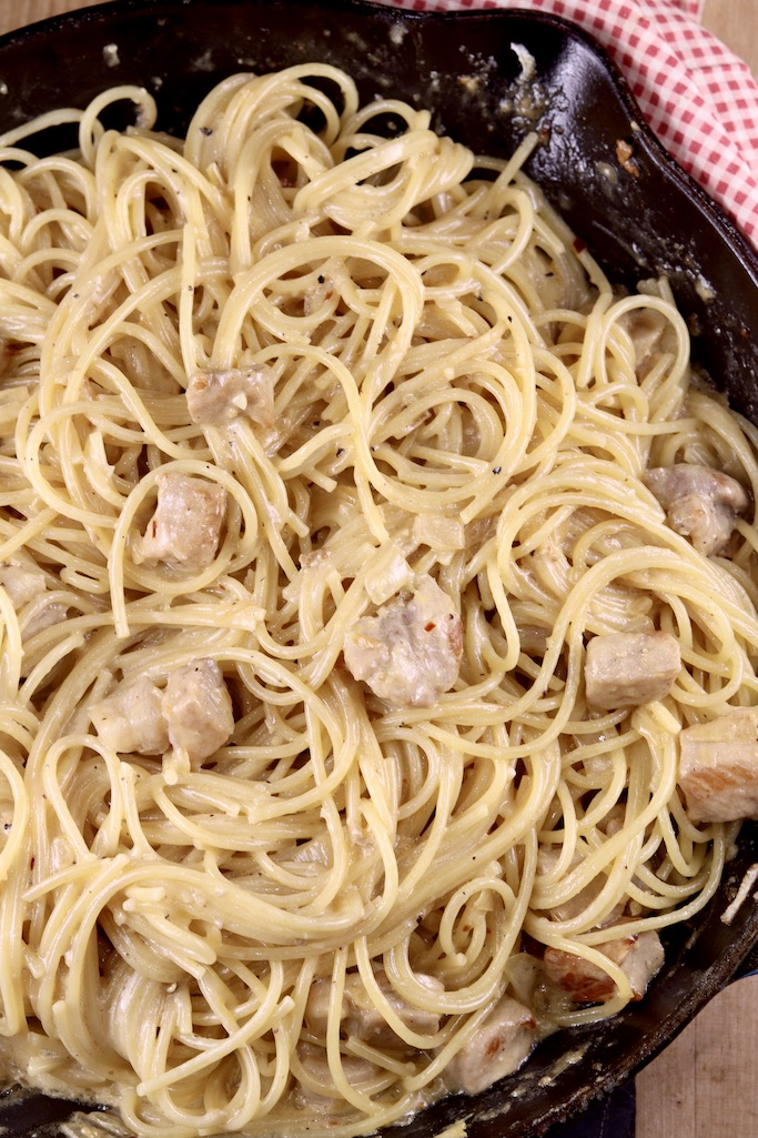 Over head view Lemon Garlic Spaghetti with pork in a skillet