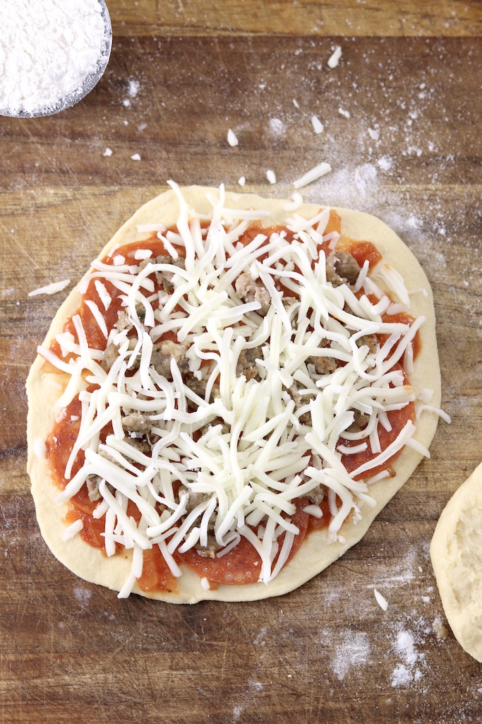 Mini biscuit pizza with pepperoni, sausage and shredded cheese