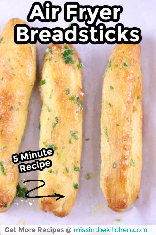 Air Fryer Breadsticks on white parchment - text overlay