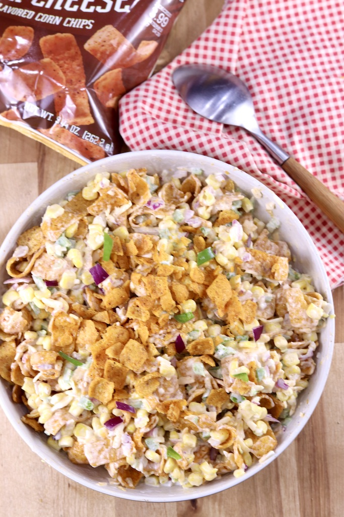 Frito Corn Salad Recipe in a bowl with red napkin and spoon
