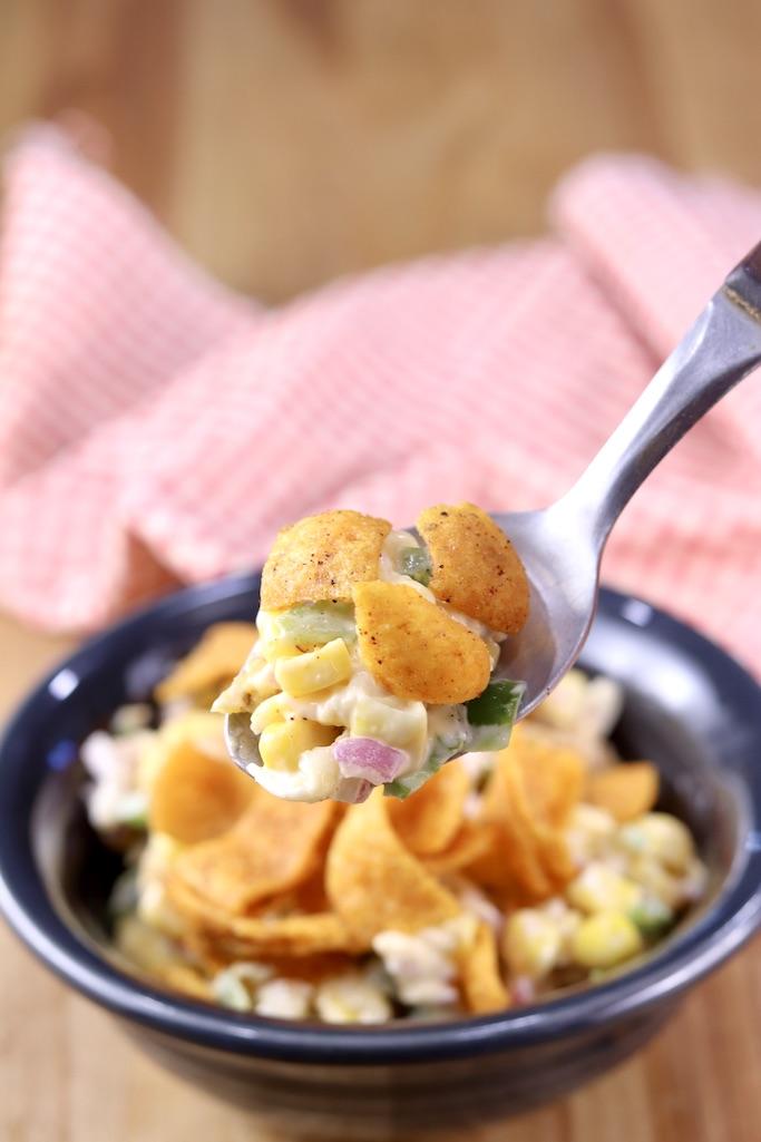 Chili Cheese Frito Corn Salad on a spoon - close view