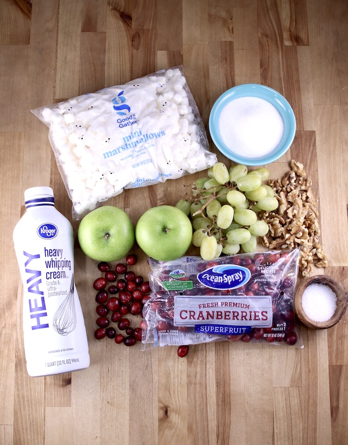 Ingredients for cranberry fluff with apples, grapes, mini marshmallows, heavy cream, walnuts, salt