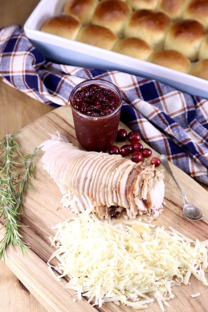 Hawaiian Rolls, Cranberry BBQ Sauce, shredded cheese, sliced smoked turkey for making sliders