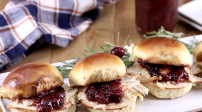 Smoked Turkey Sliders on a platter with cranberry bbq sauce