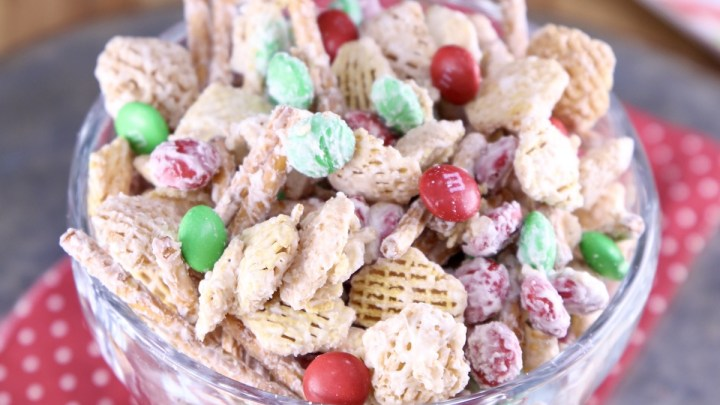 White Trash Snack Mix in a bowl with Christmas M&M's