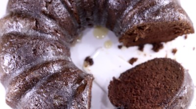 Chocolate Rum Bundt Cake with slice of cake on platter with the cake