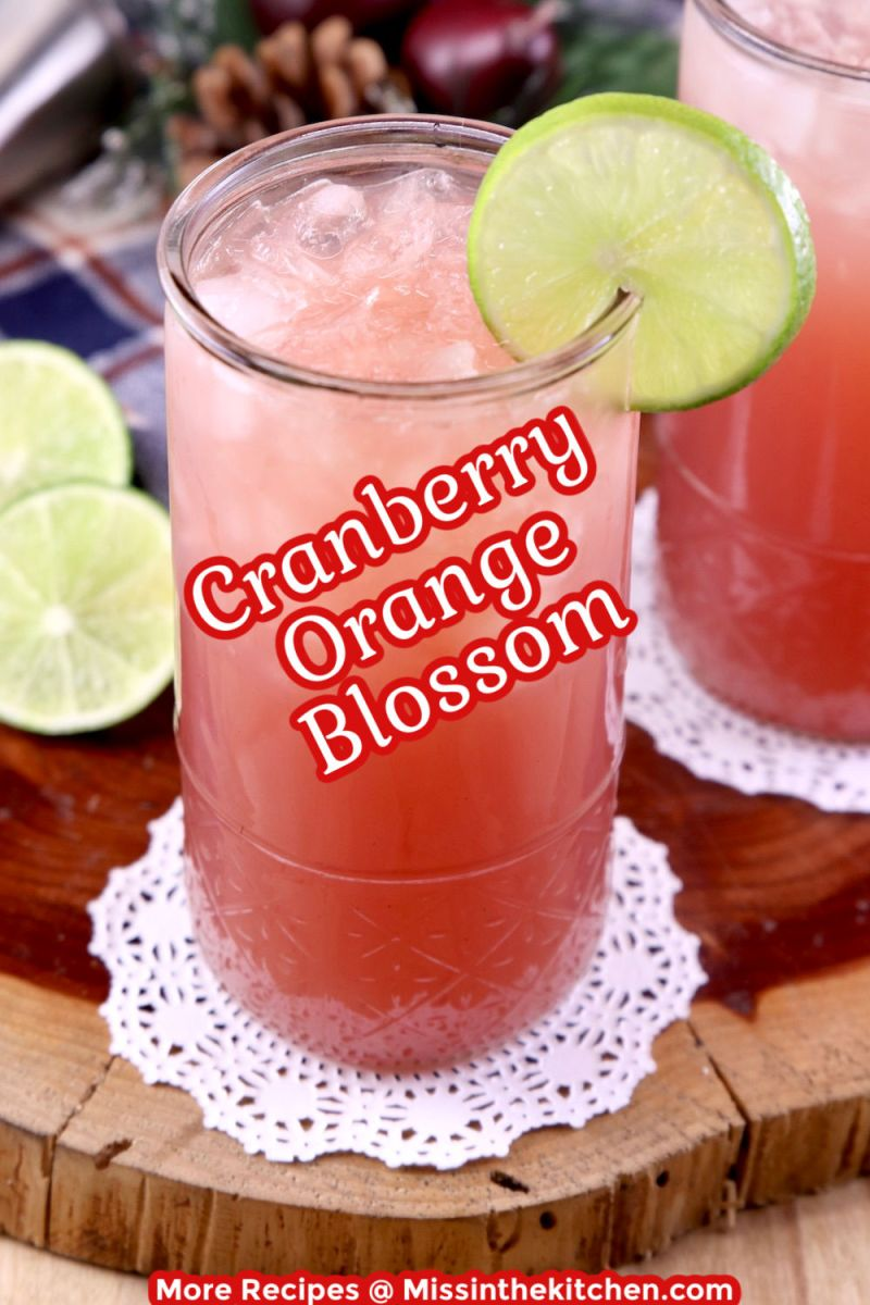 Cranberry Orange Blossom Cocktail in a glass - text overlay