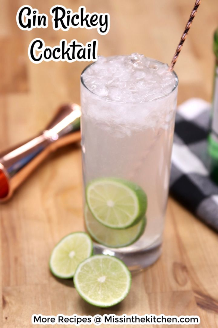 Gin Rickey Cocktail in a collins glass with lime garnish and a cocktail stirring spoon - text overlay