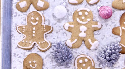 Decorated Gingerbread Cookies on a tray with Christmas Ornaments