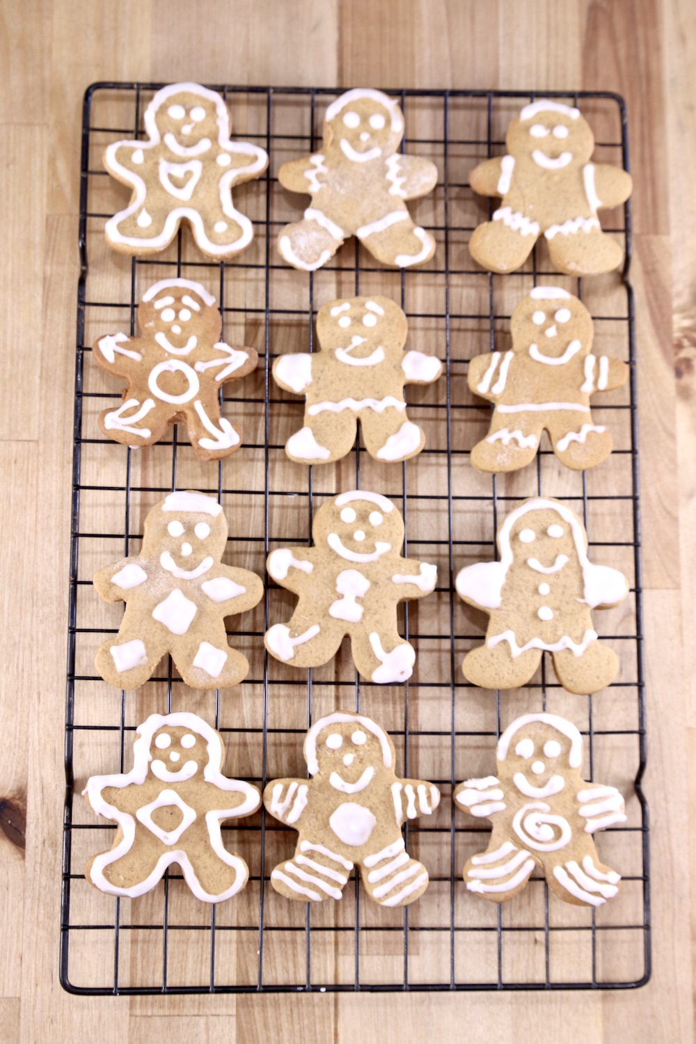 Decorated gingerbread men cookies on a wire rack