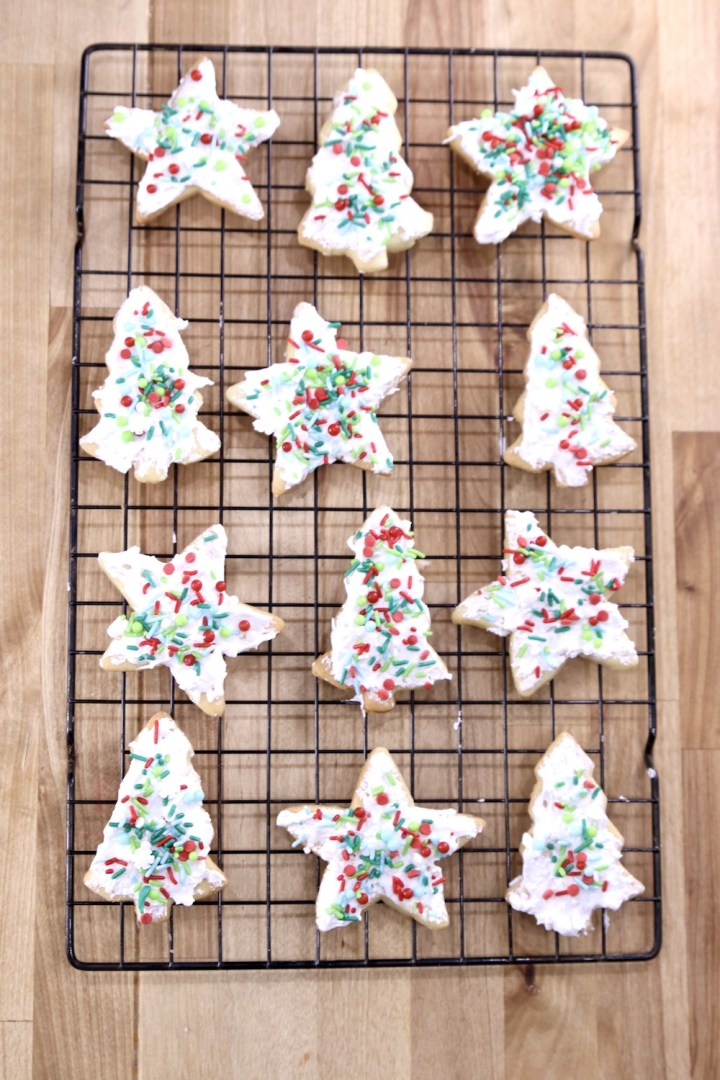 Sugar Cookies with icing and sprinkles on a wire rack