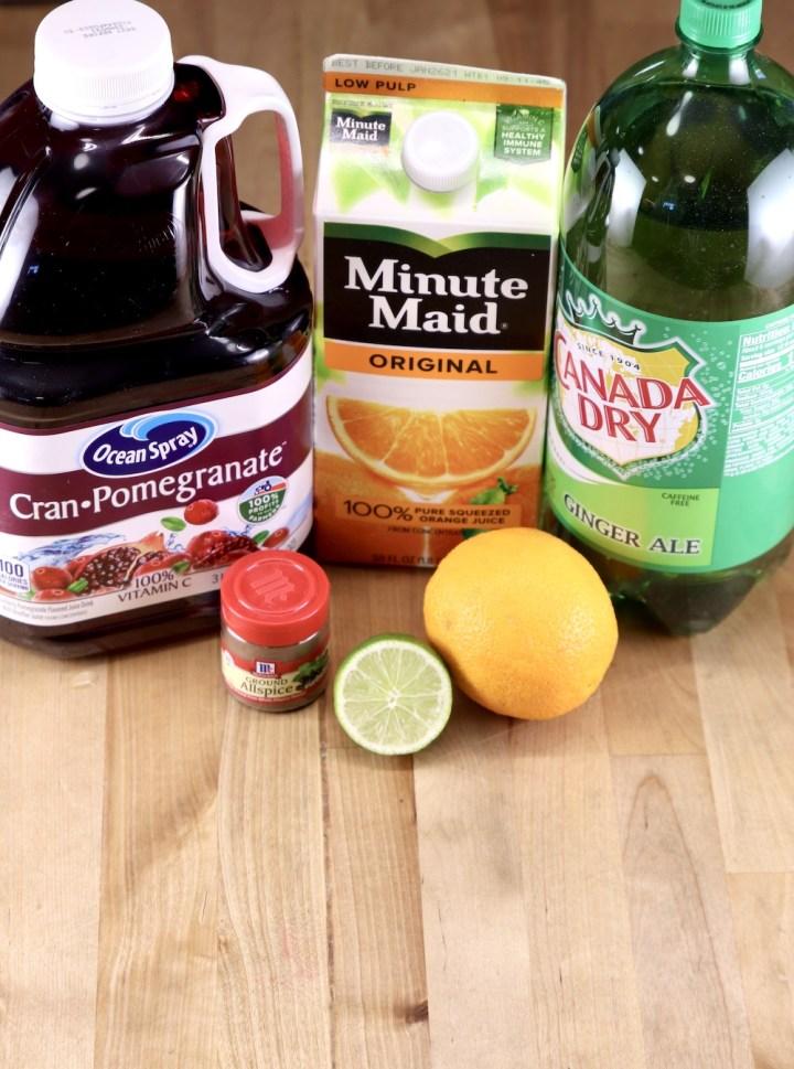 ingredients for Christmas Punch: Cranberry Juice, Orange Juice, Ginger Ale, Allspice, Orange, Lime