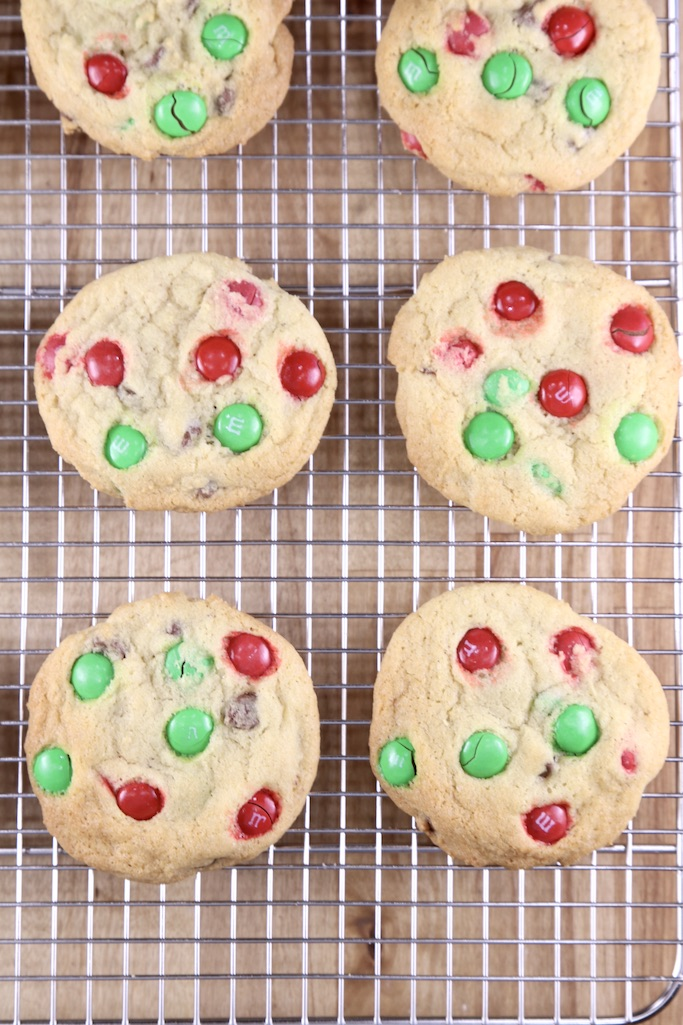 6 M&M Cookies on a wire rack