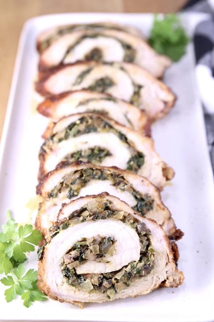platter of slices of stuffed pork tenderloin