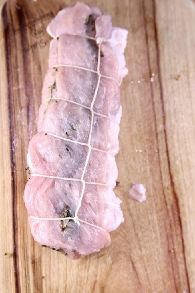 stuffed pork tenderloin tied with butcher twine