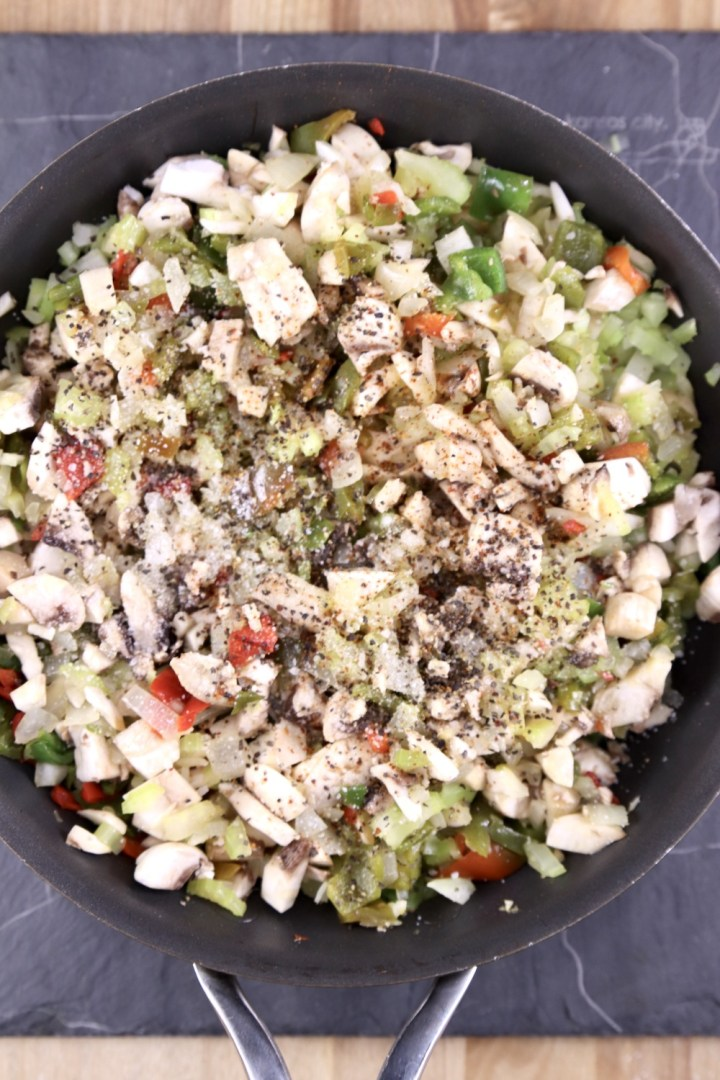cooked mushrooms, onions, celery and bell peppers in a skillet