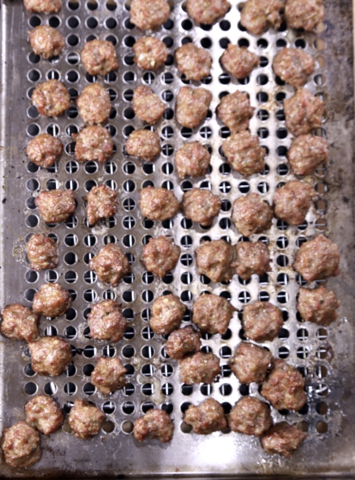 Grilled meatballs on a grill pan - overhead view
