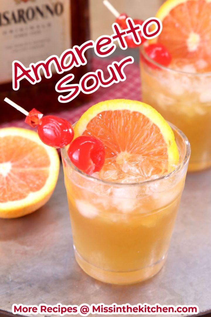 Amaretto Sour Cocktail with orange and cherry garnish - text overlay for pinterest