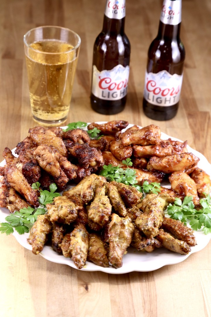 Platter of chicken wings with Coors Beer in a glass and 2 bottles