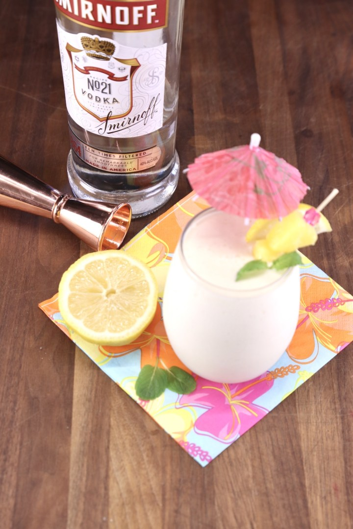 bottle of Smirnoff vodka with glass of Frozen Pineapple Lemonade