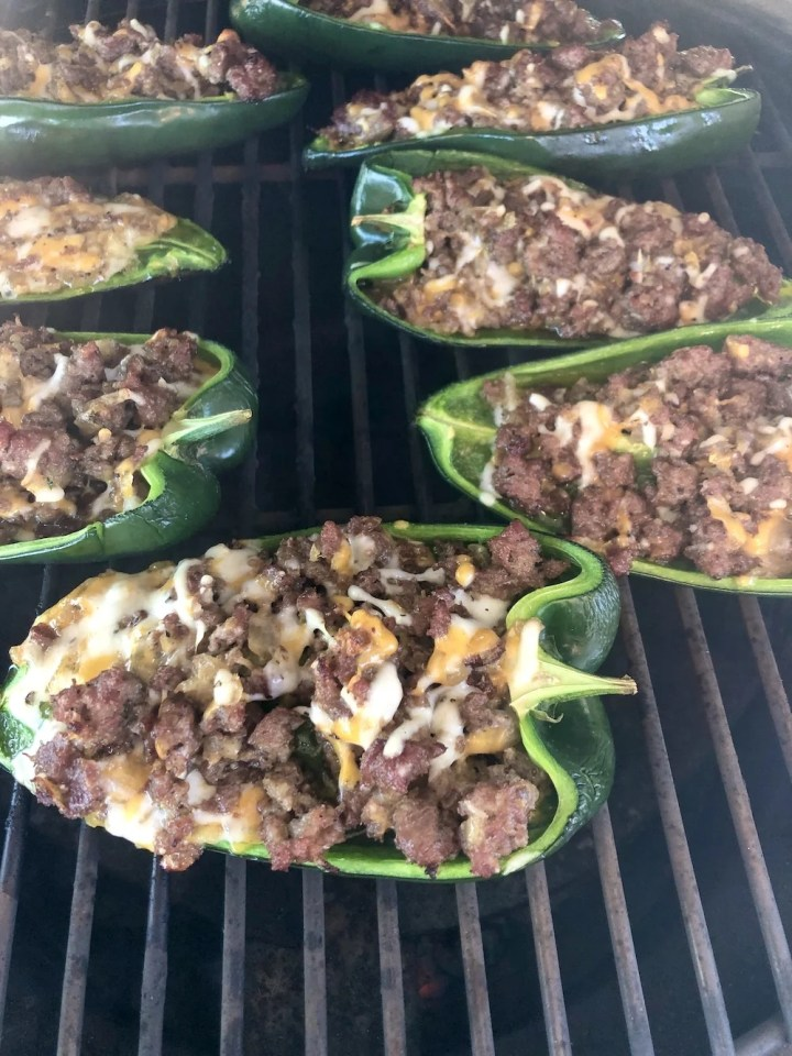 Grilled stuffed poblano peppers on a grill