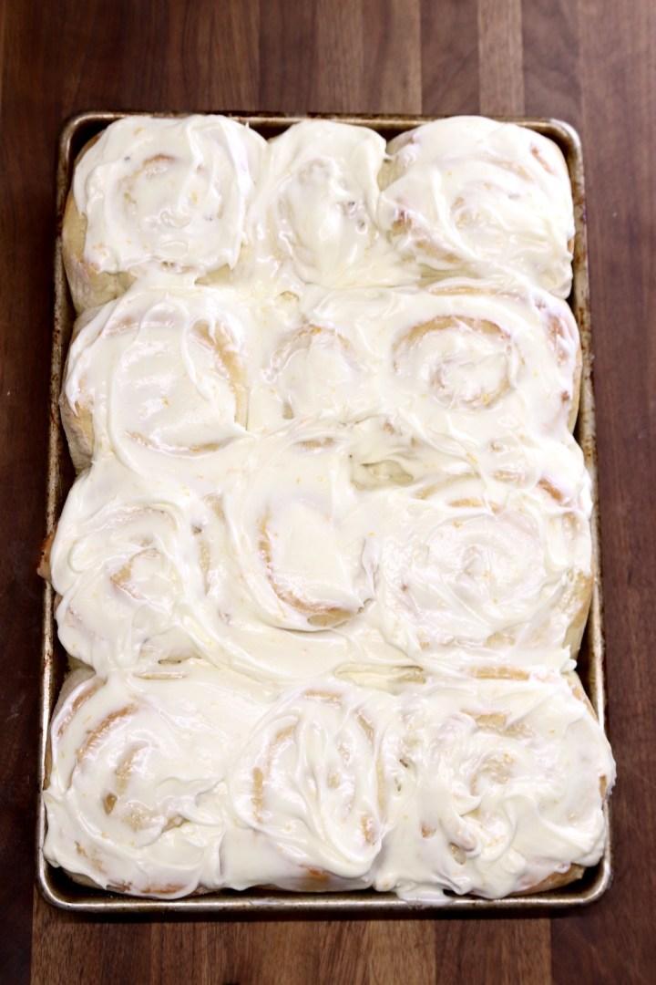 pan of cream cheese iced sweet rolls