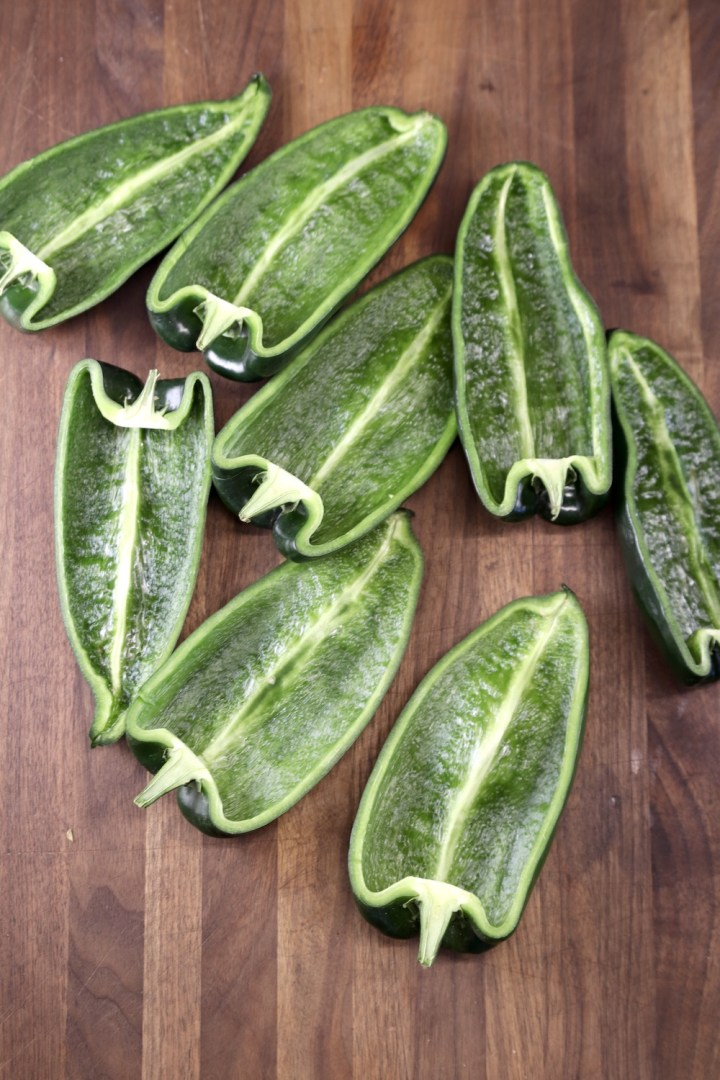 poblano peppers sliced in half - seeds removed
