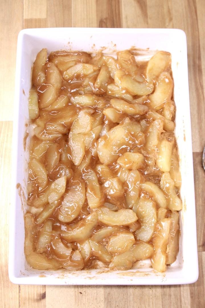 cinnamon apple pie filling in a cake pan