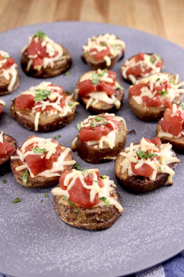 Bruschetta Butter Potatoes on a gray plate