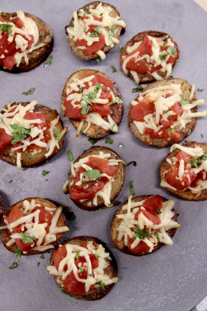 Bruschetta Butter Potatoes on a gray tray