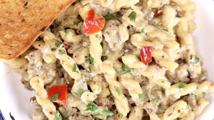Creamy Italian Sausage Pasta with bell peppers and garlic toast