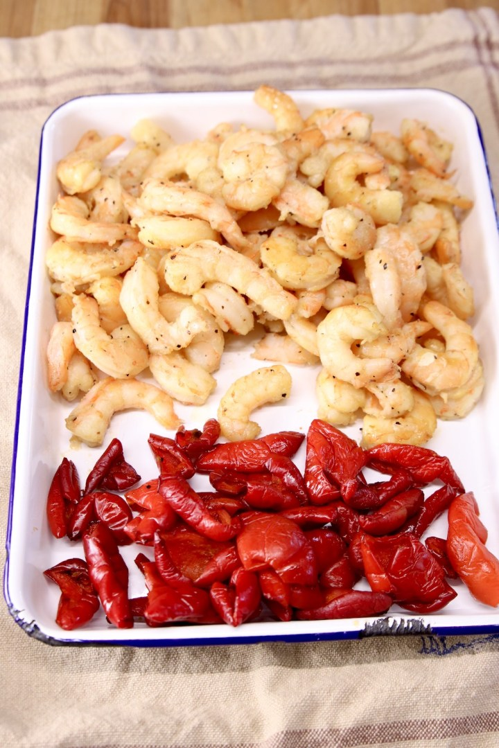 tray of grilled shrimp and red bell peppers