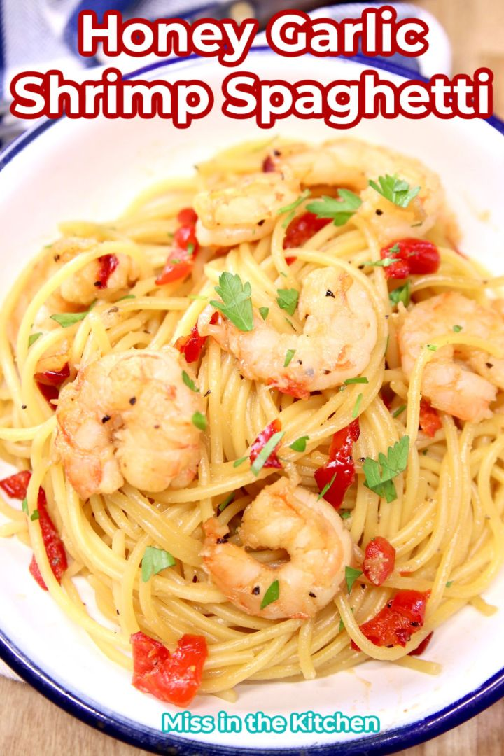 bowl of spaghetti with shrimp and red bell peppers - text overlay
