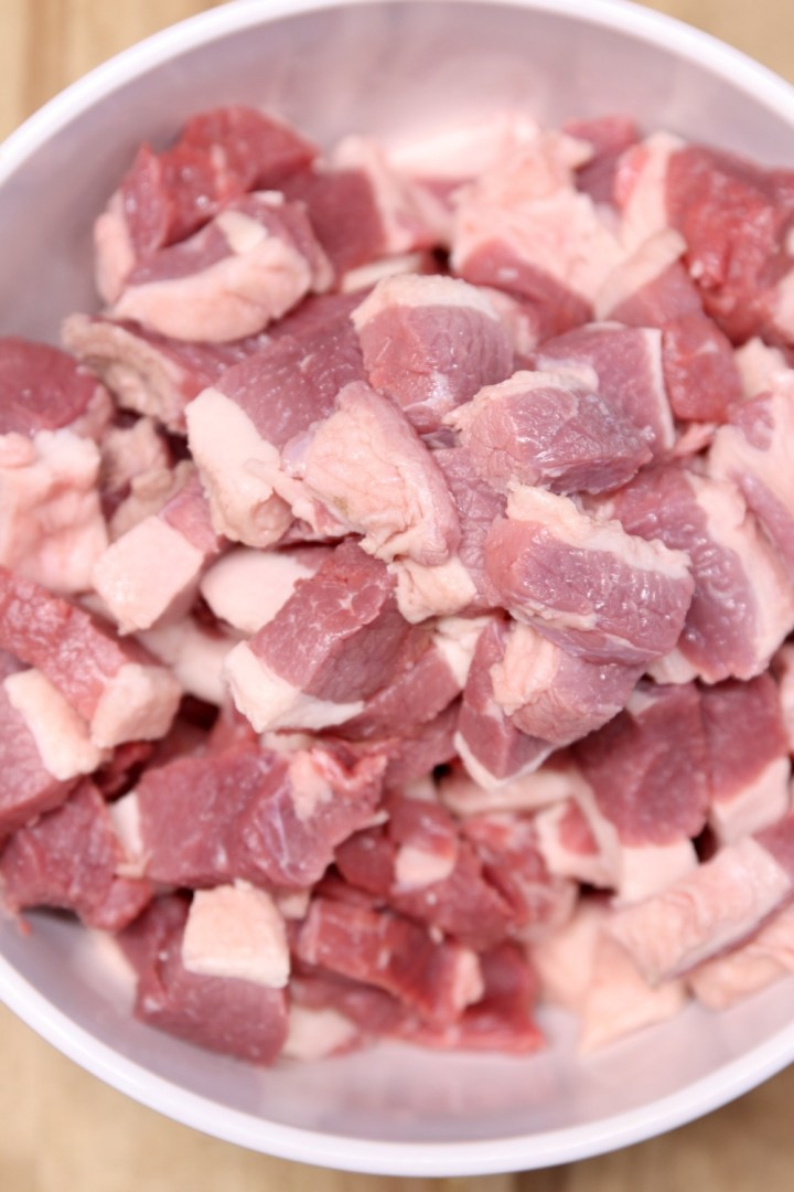 chunks of pork shoulder in a bowl for making sausage