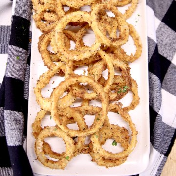 platter of onion rings on a black and white check napkin