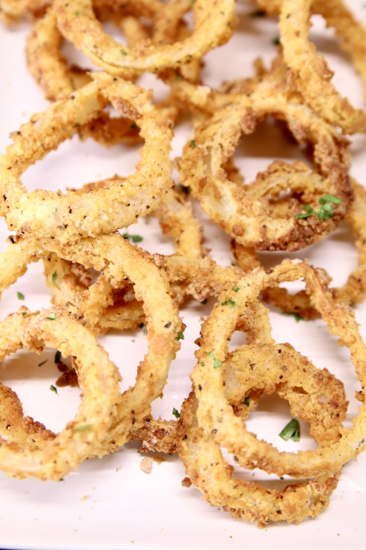 closeup of onion rings on a platter