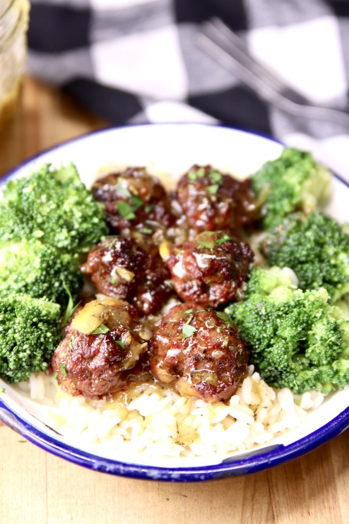 meatballs with orange sauce and broccoli served over rice