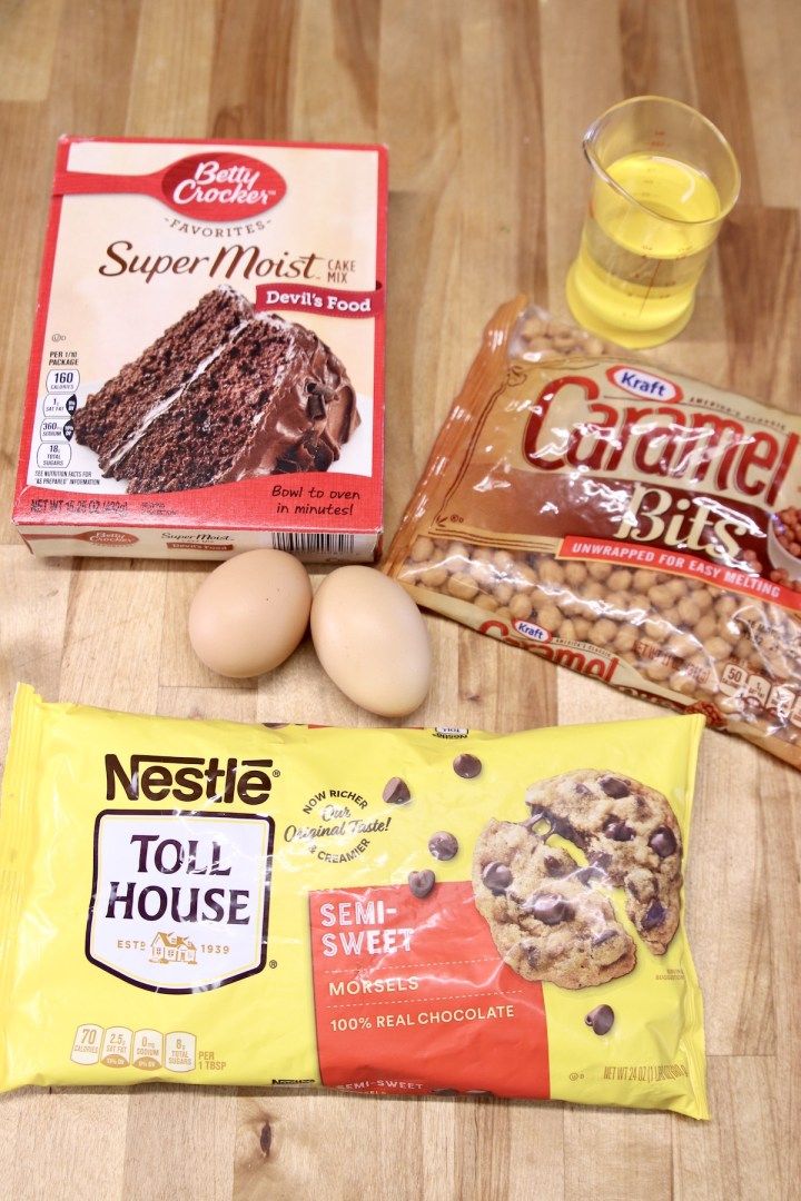 ingredients for cake mix cookies with chocolate chips and caramel bits