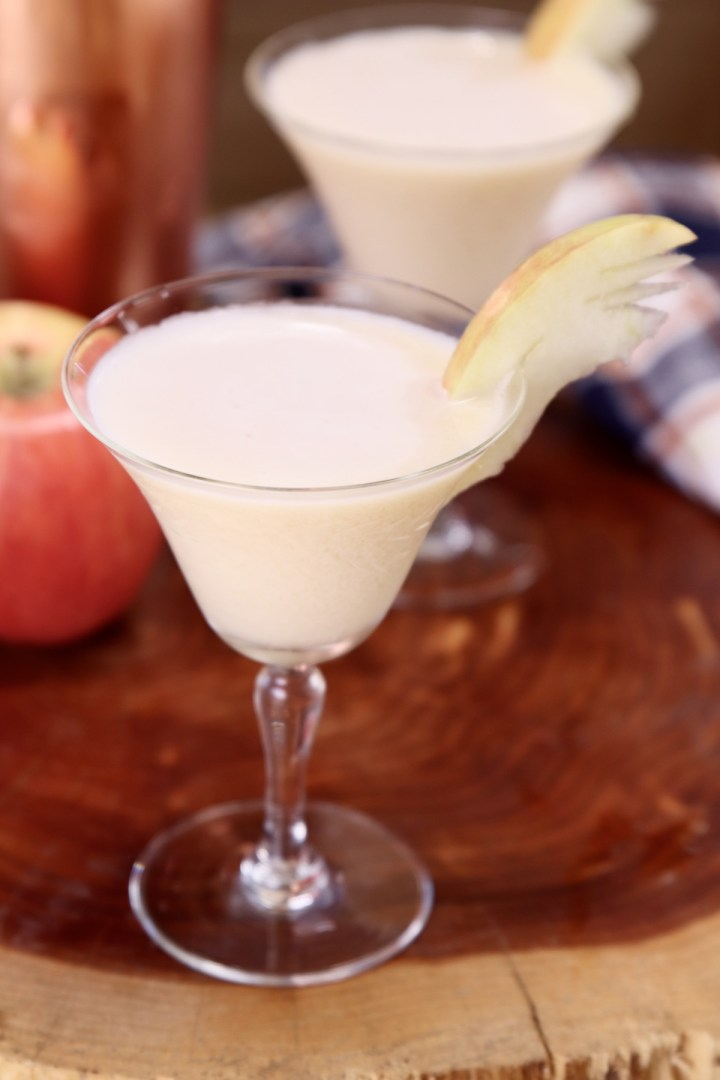 caramel apple martini in a coupe glass with apple fan garnish